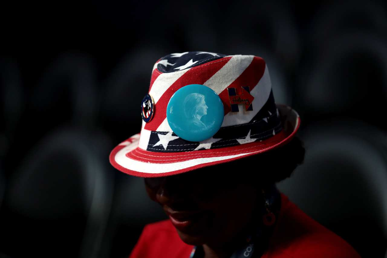 An attendee wears a hat with campaign memorabilia prior to the start of the third day of the Democratic National Convention in Philadelphia in July.<span>Drew Angerer/Getty Images</span>