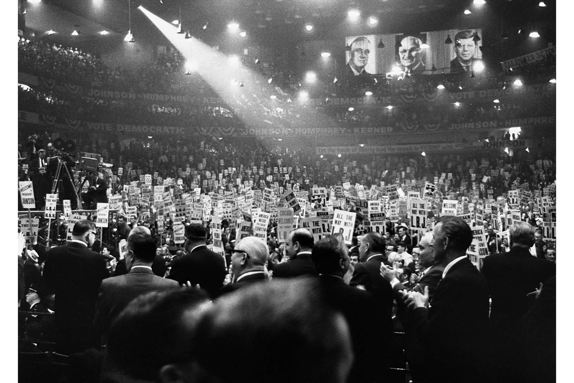 A crowd of delegates hold signs supporting Lyndon B. Johnson for president at the 1964 Democratic National Convention in Atlantic City, New Jersey. | <span>Corbis/Getty</span>