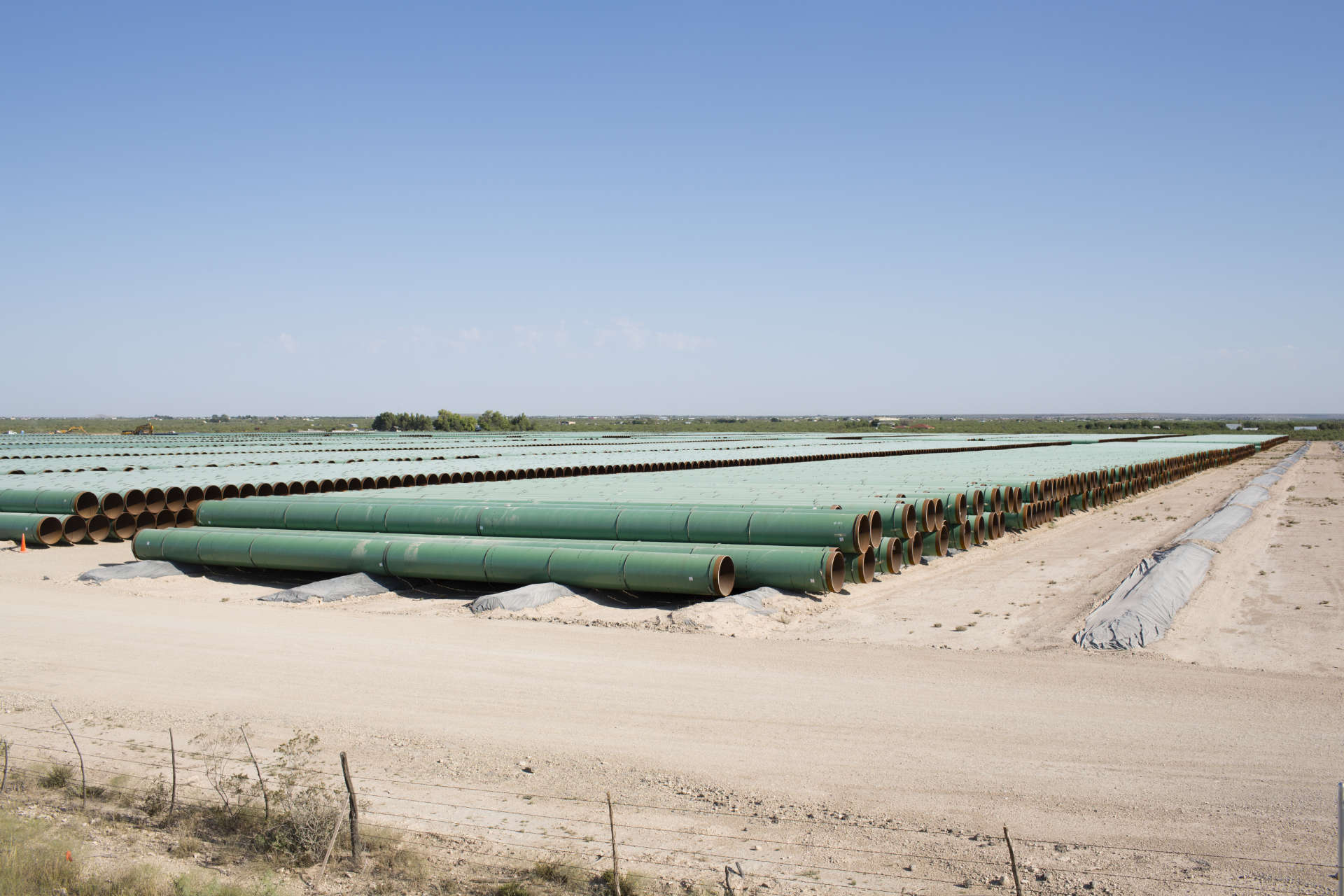 Sections of pipe for the proposed 143-mile Trans-Pecos Pipeline are stacked near Fort Stockton, Texas.