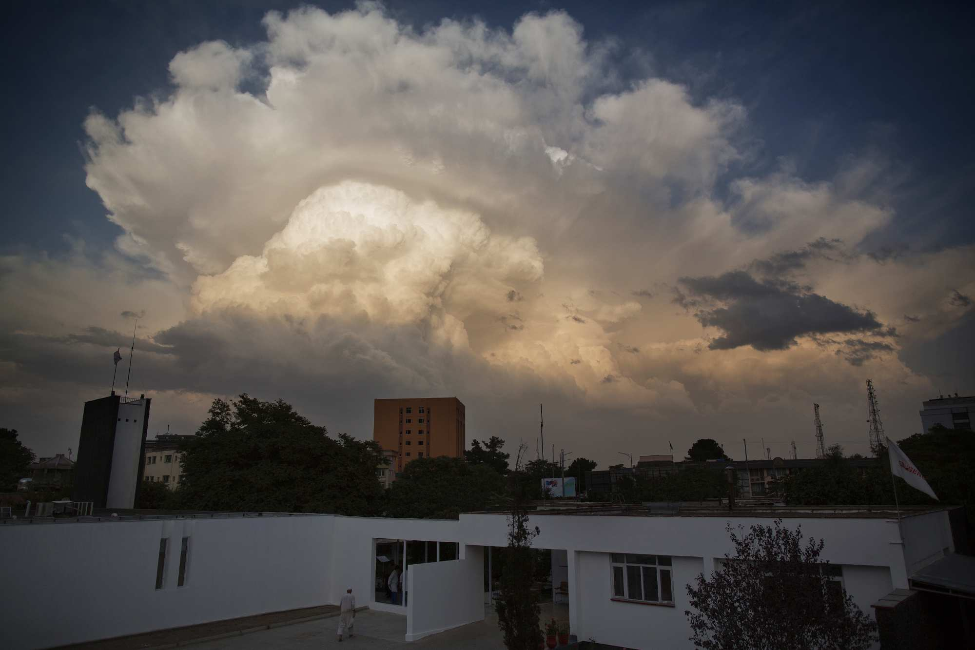 Thunderheads form in the afternoon over Emergency Surgical Center in Kabul.