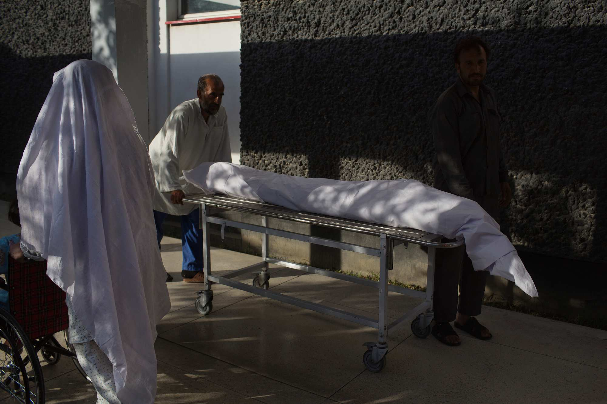 Nurses wheel the body of Shafiullah, 18, to the morgue at Emergency. Shafiullah, from Kabul, suffered a bullet to the head, in and out, from temple to temple. He died in the ICU on September 30.