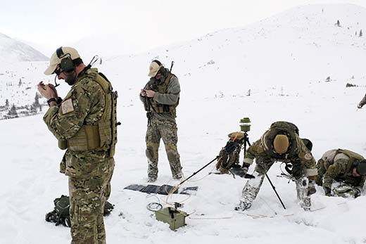 A team of combat weather operators employs a weather pod at a remote location in in Alaska.