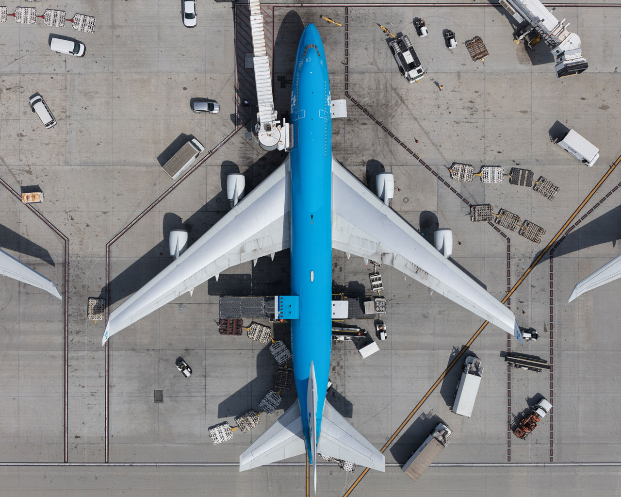 A KLM 747 unloads at a gate at LAX.