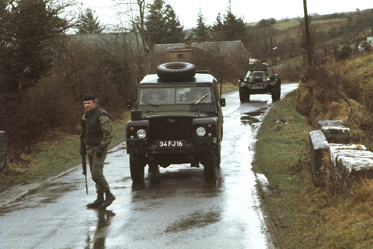 A British soldier looks for roadside bombs during an armored patrol in County Fermanagh, close to the border with the Irish Republic, in January 1978. | Alex Bowie / Getty Images