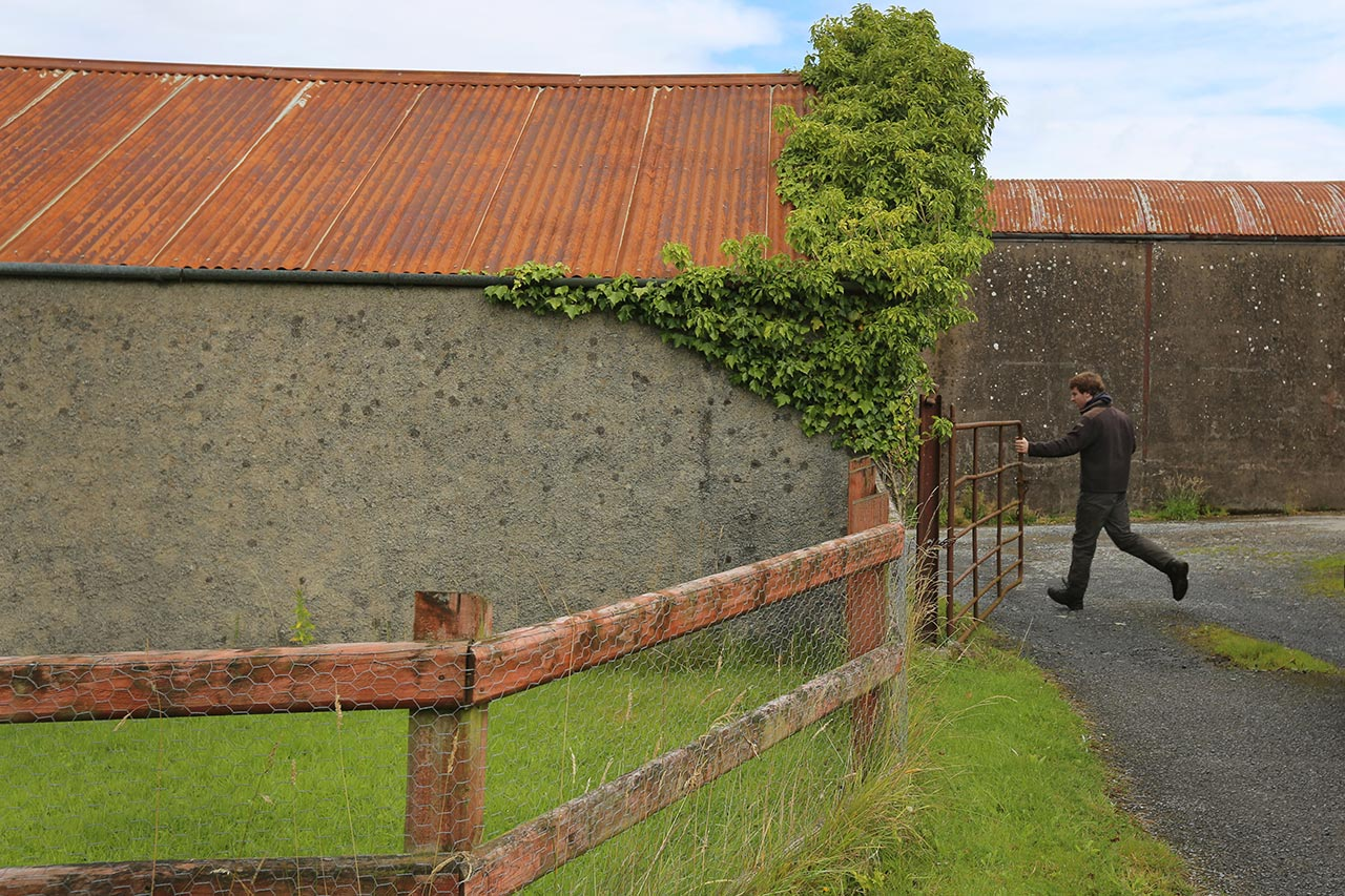 John Sheridan's son, Chris, opens the gate to a farm in County Fermanagh, Northern Ireland.