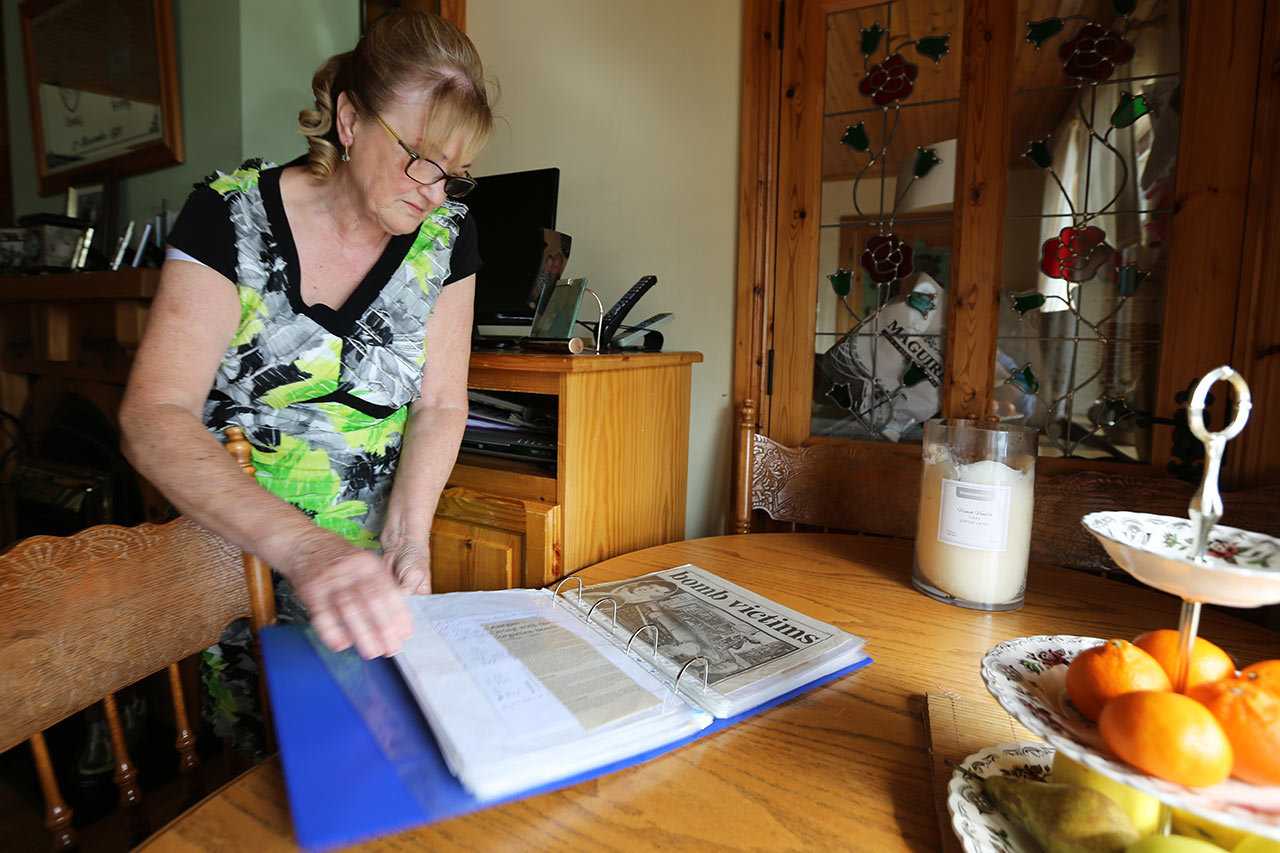Marie O'Reilly has collected newspaper clippings of articles on a 1972 bombing that killed her sister-in-law, Geraldine.