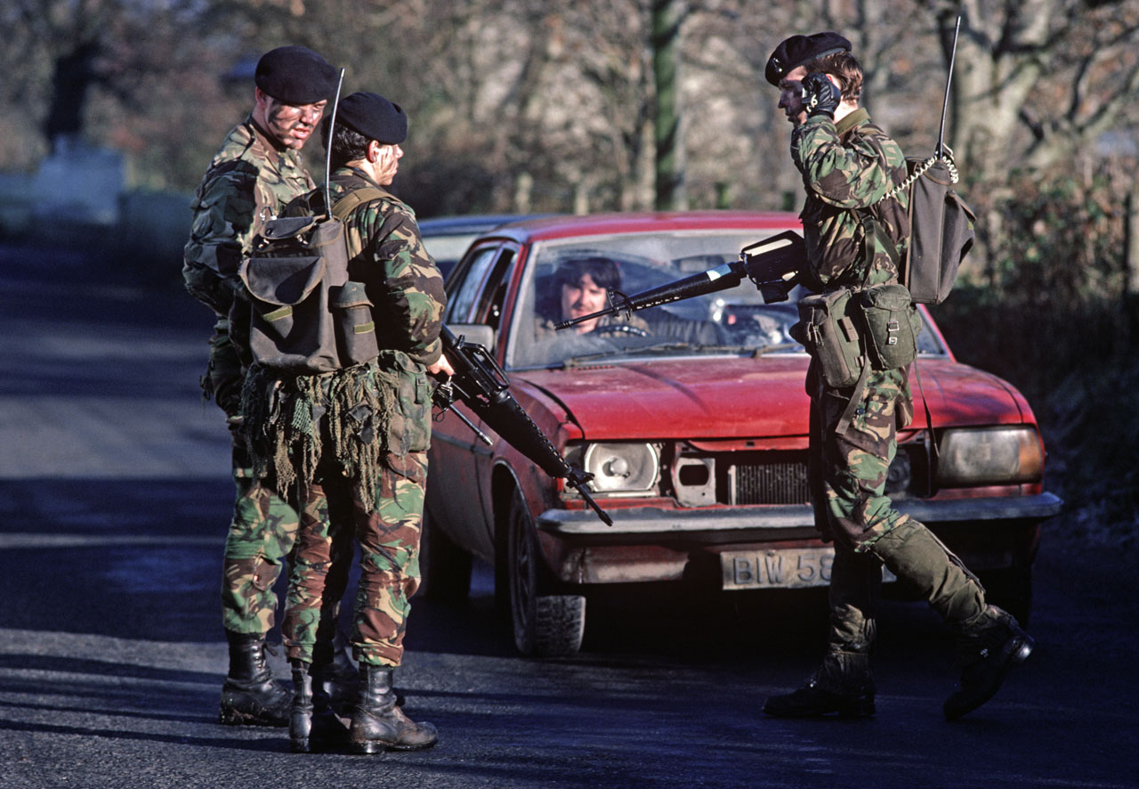 British Army Soldiers check vehicles near the border with the Republic of Ireland during The Troubles in December 1985.