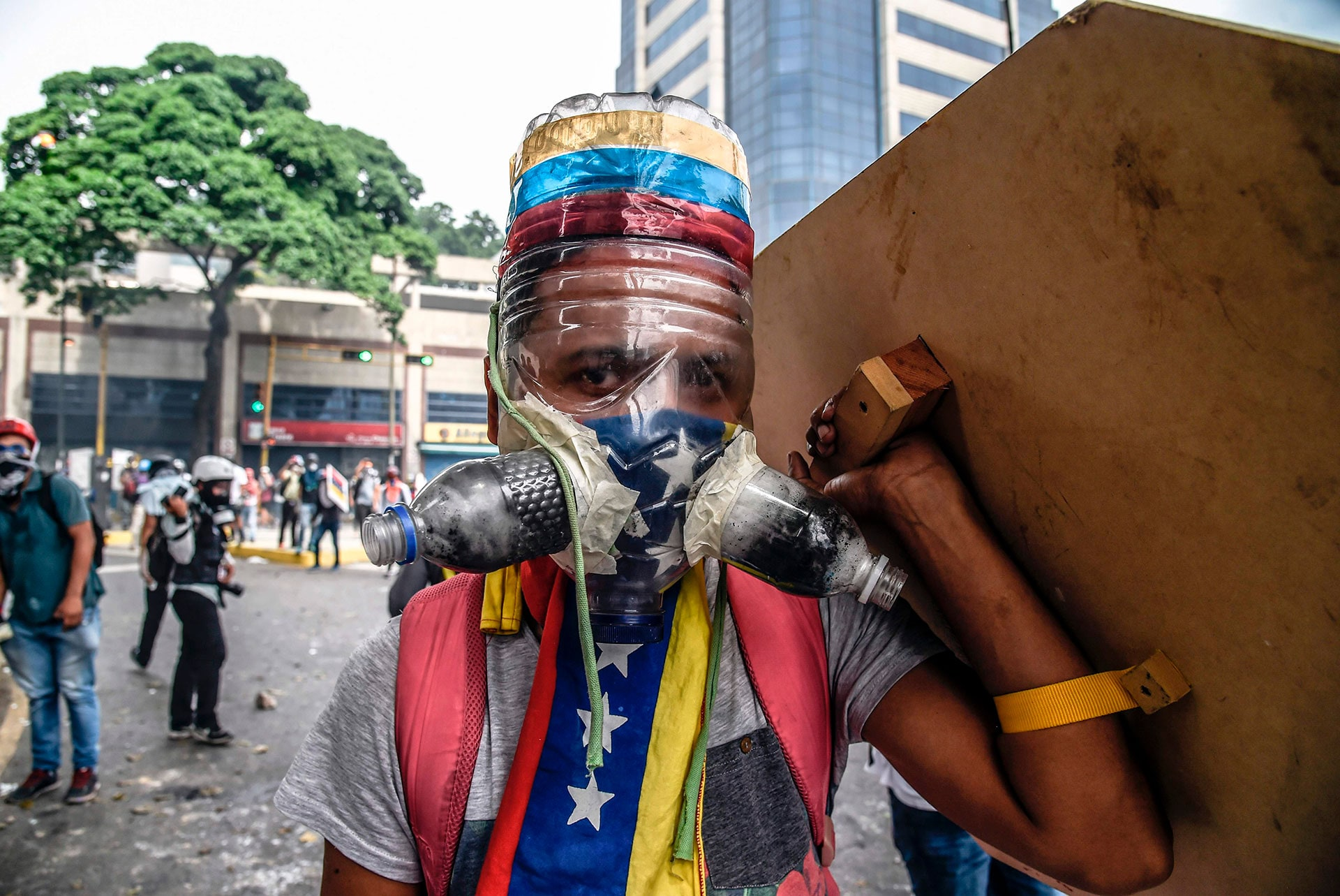 A Venezuelan opposition activist wearing a homemade gas mask