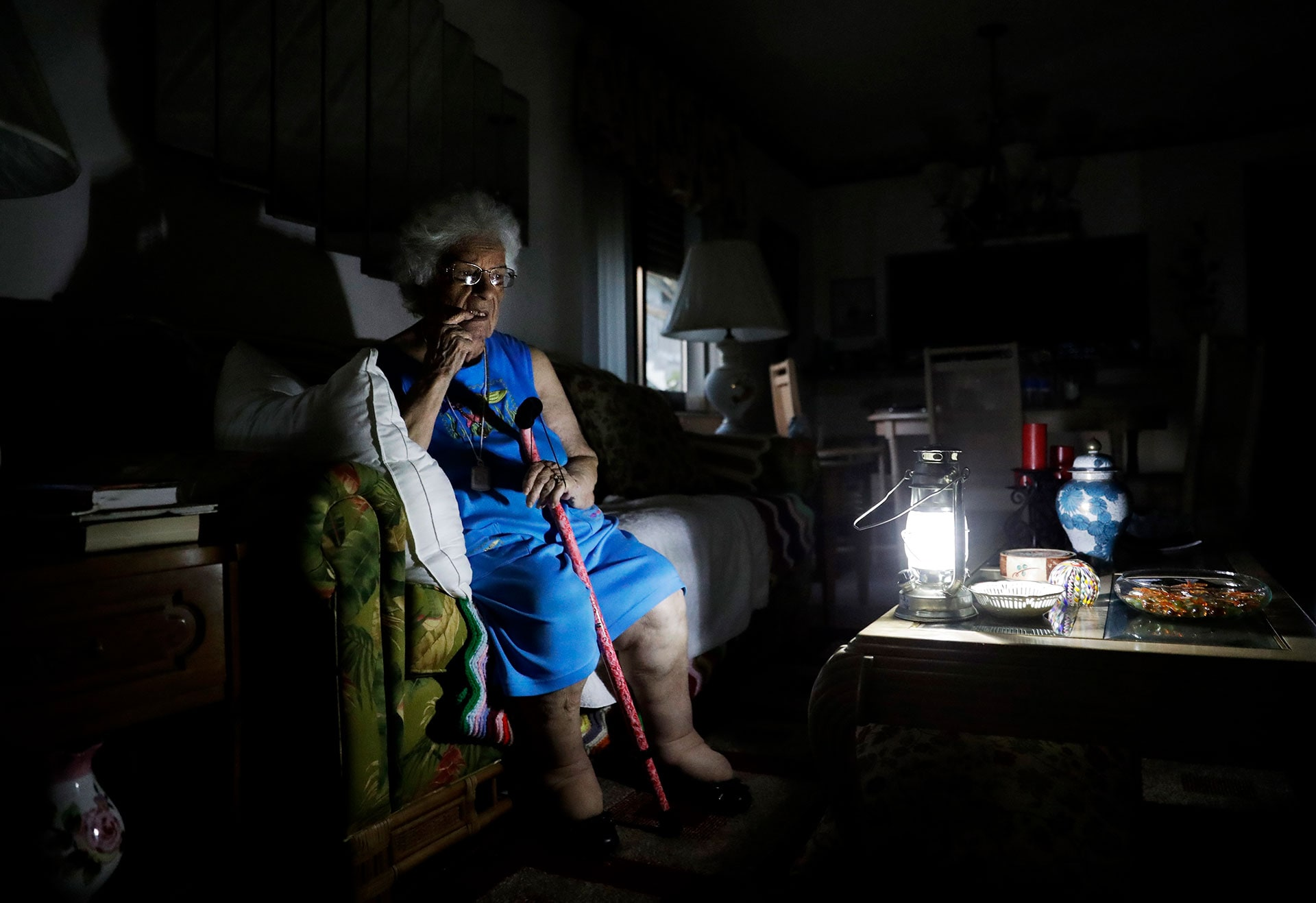 Mary Della Ratta, 94, sits by a battery-powered lantern in her home