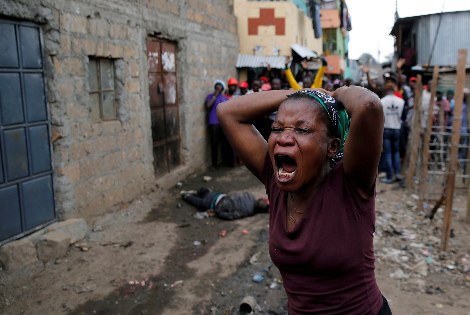 A woman screams as she mourns the death of a protester