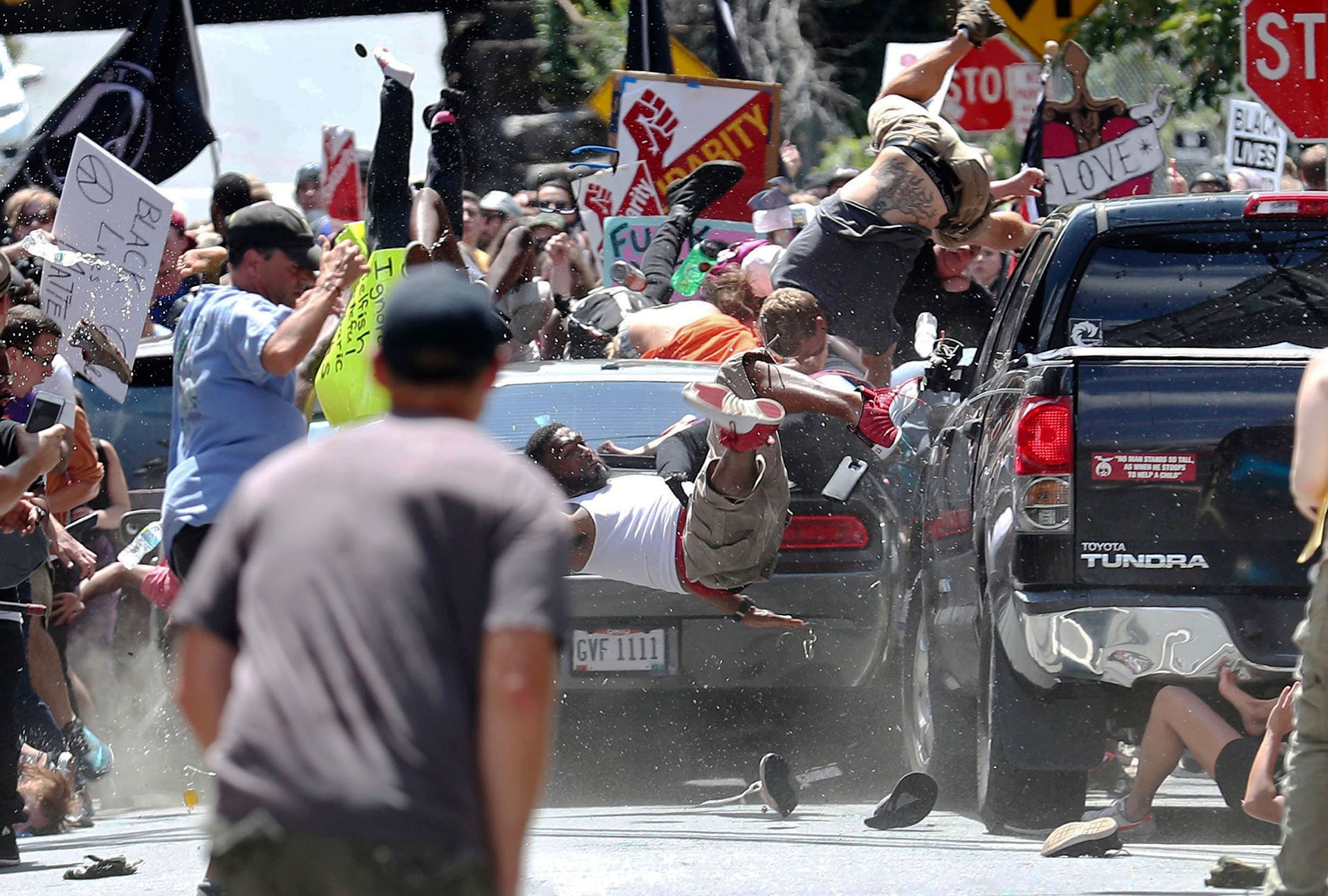A vehicle drives into a group of counterprotesters demonstrating against a white nationalist