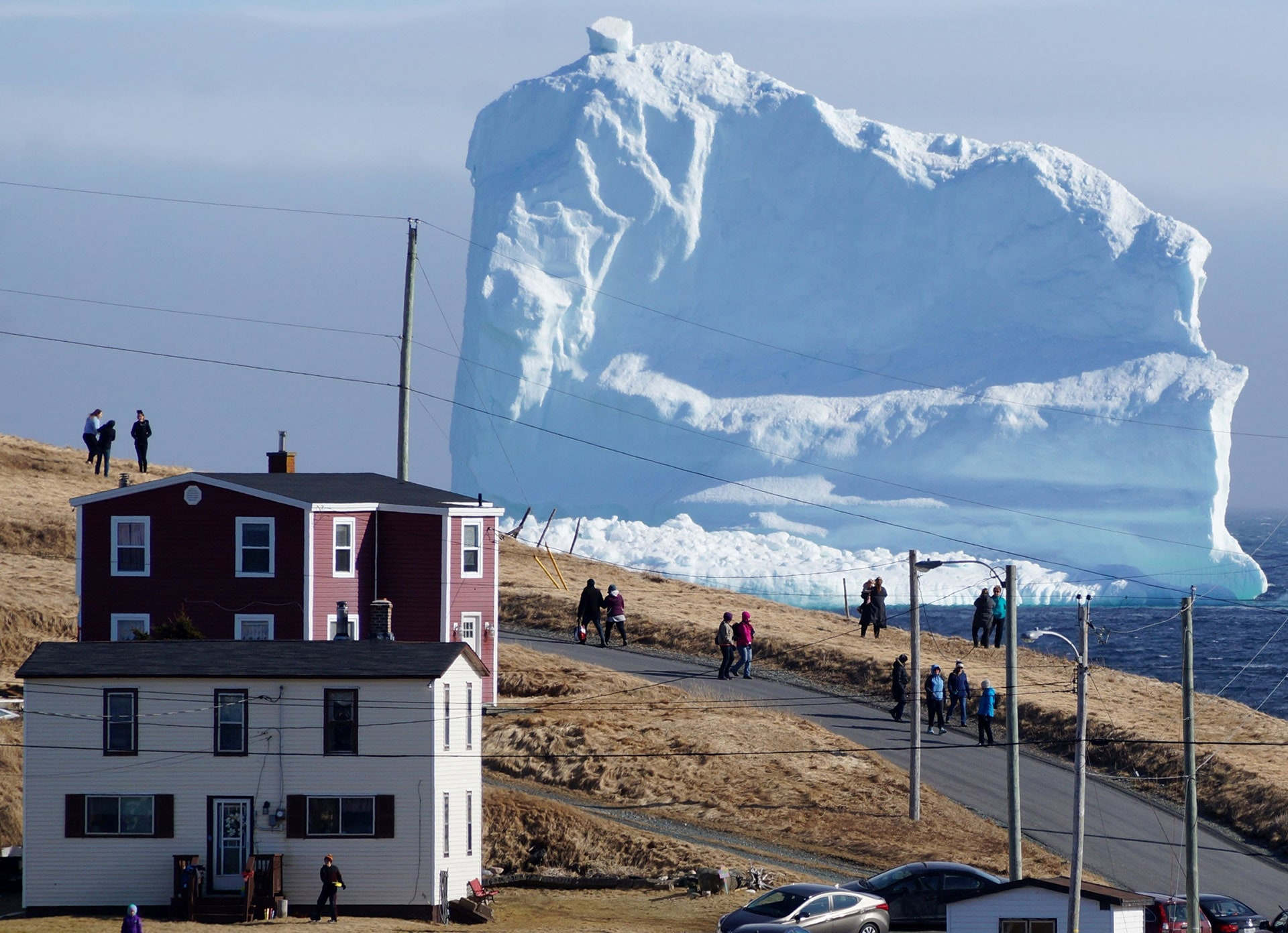 Residents view the first iceberg of the season as it passes the South Shore