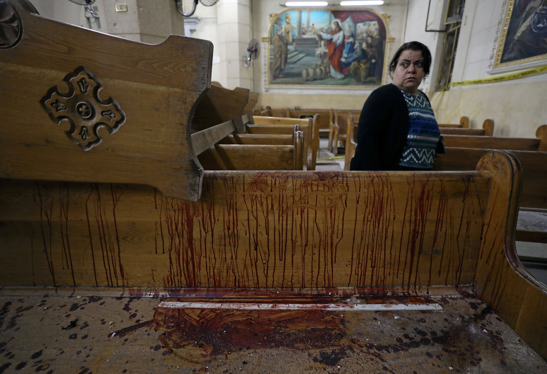 A pew inside a Coptic Christian church is covered in blood