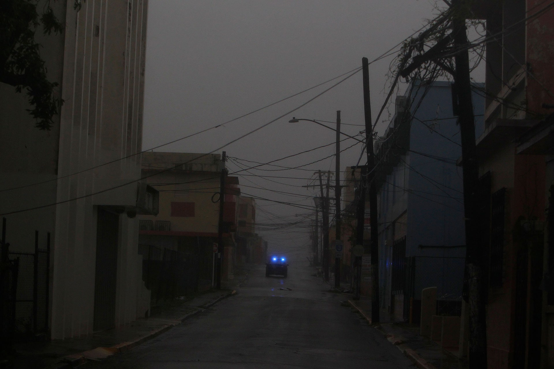 A police car patrols Fajardo, Puerto Rico, as Hurricane Maria hits