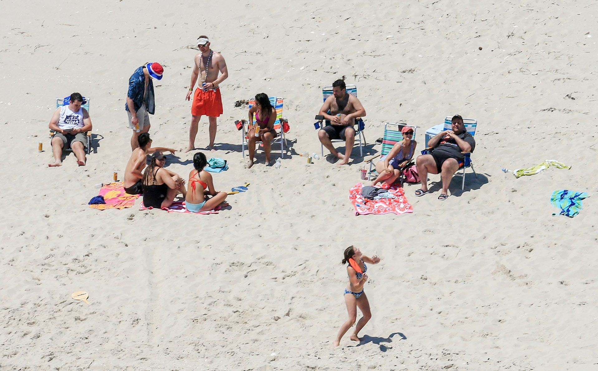 New Jersey Gov. Chris Christie, right, enjoys the beach with his family and friends