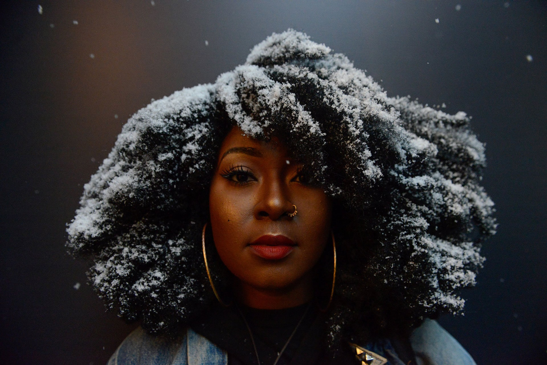 Snow covers Kandy Freeman's hair as she participates in a Black Lives Matter protest