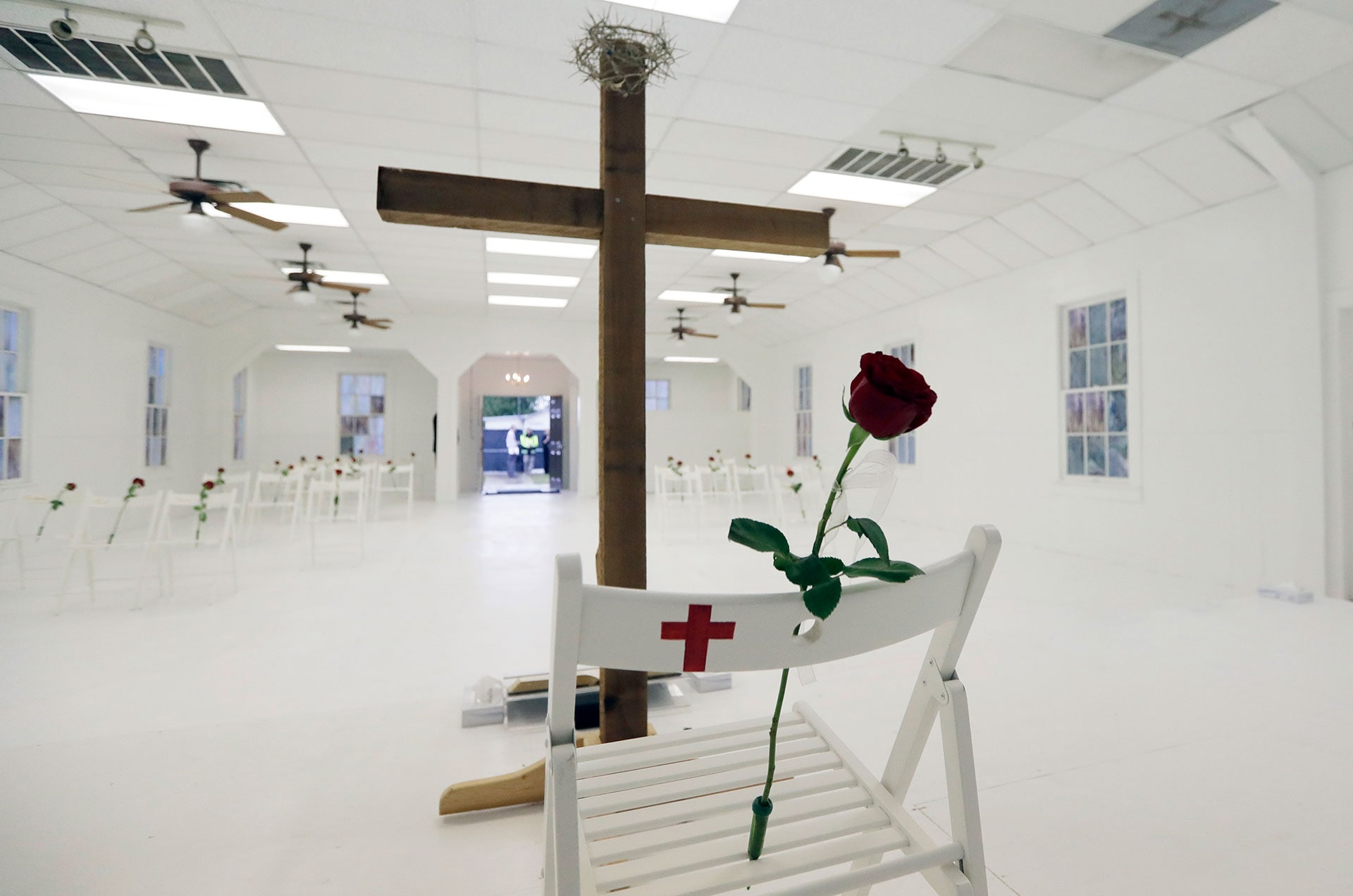 Roses are placed on chairs inside the First Baptist Church in Sutherland Springs, Texas