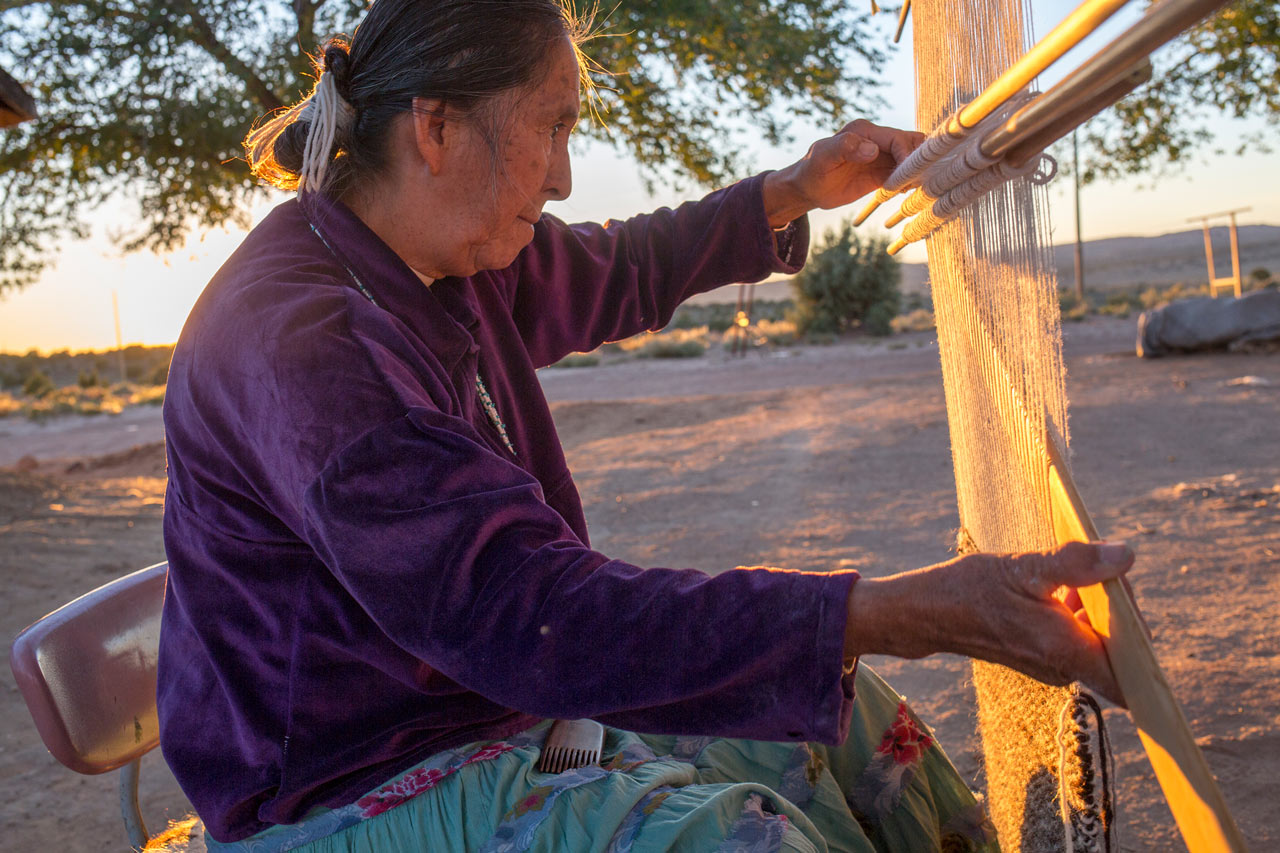 Edith Simonson weaves rugs in the Navajo tradition. She and other weavers worry that native plants, needed to dye wool, are suffering because of a lack of water.