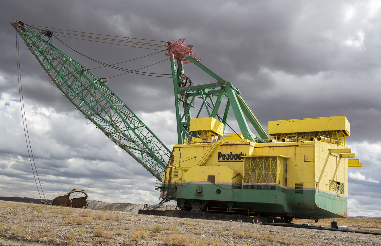 Draglines are the massive earth movers that scrape away soil to expose the wide seams of coal beneath.