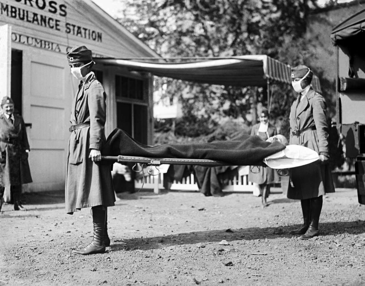 two Red Cross nurses with a person on a stretcher, 1918