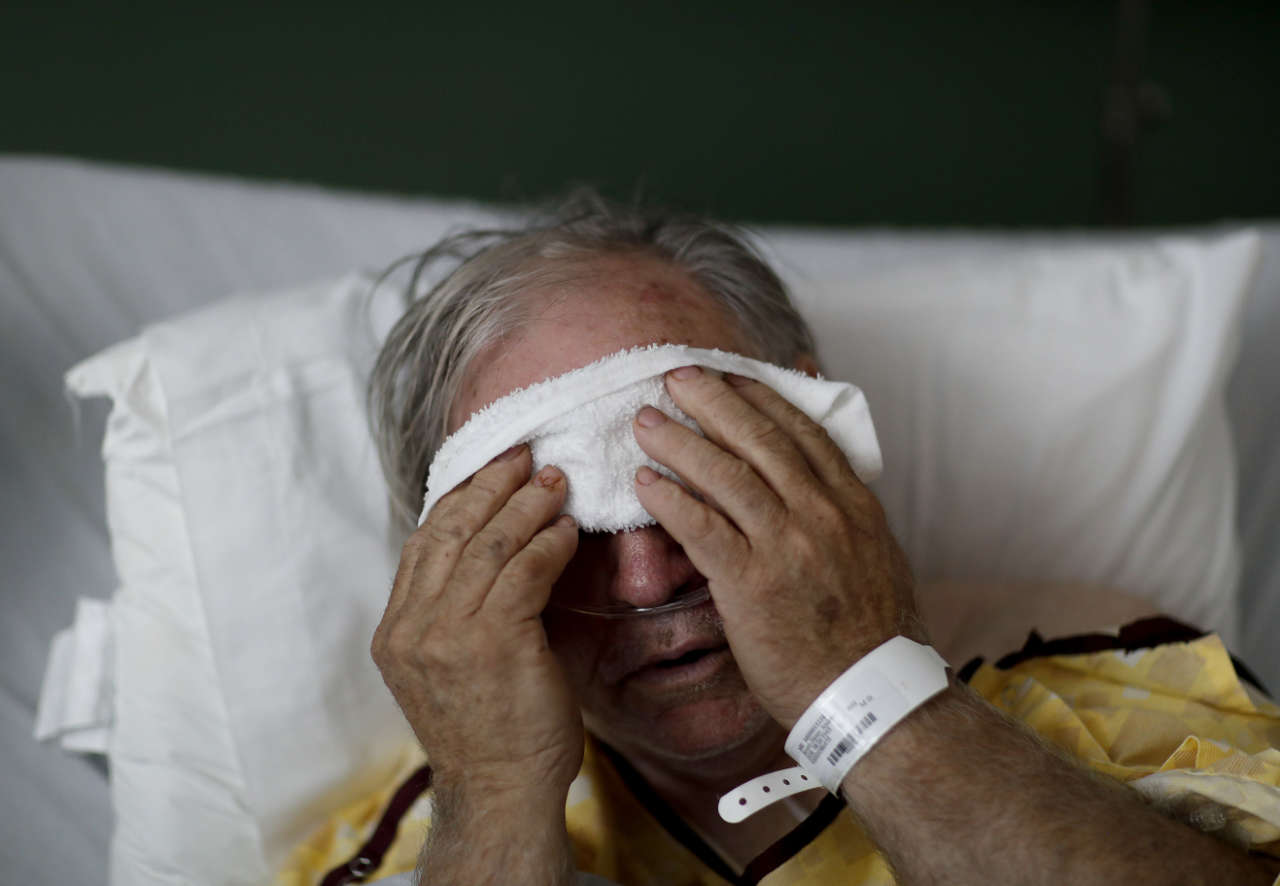 man, age 73, places a cold compress on his forehead