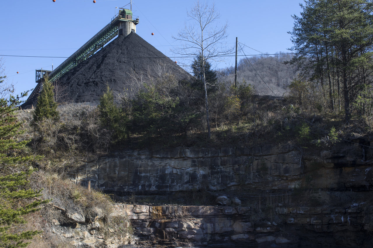 A pile of coal awaits shipping near the proposed federal prison site outside Whitesburg