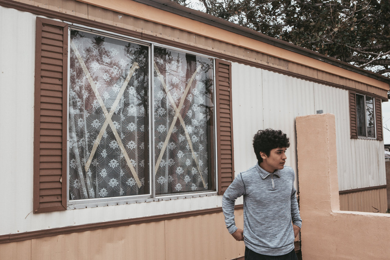 David Castillo outside the Rockport trailer he and his family now live in.