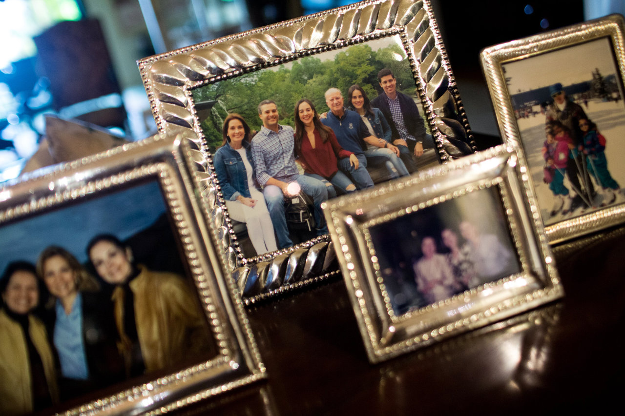 Family photos of the Atencios decorate their Caracas home.