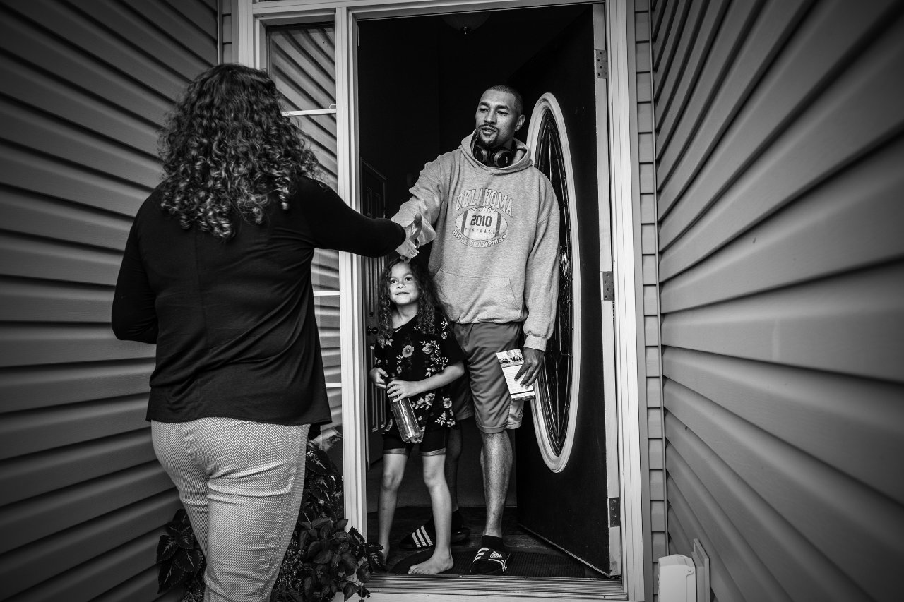 Kara Eastman greets residents as she canvasses in support of her run for Congress in Omaha, Nebraska.