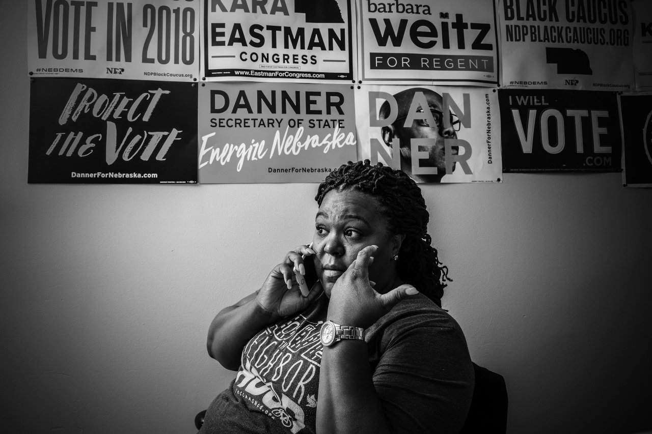 Precious McKesson works the phones in her office in Omaha, Nebraska.