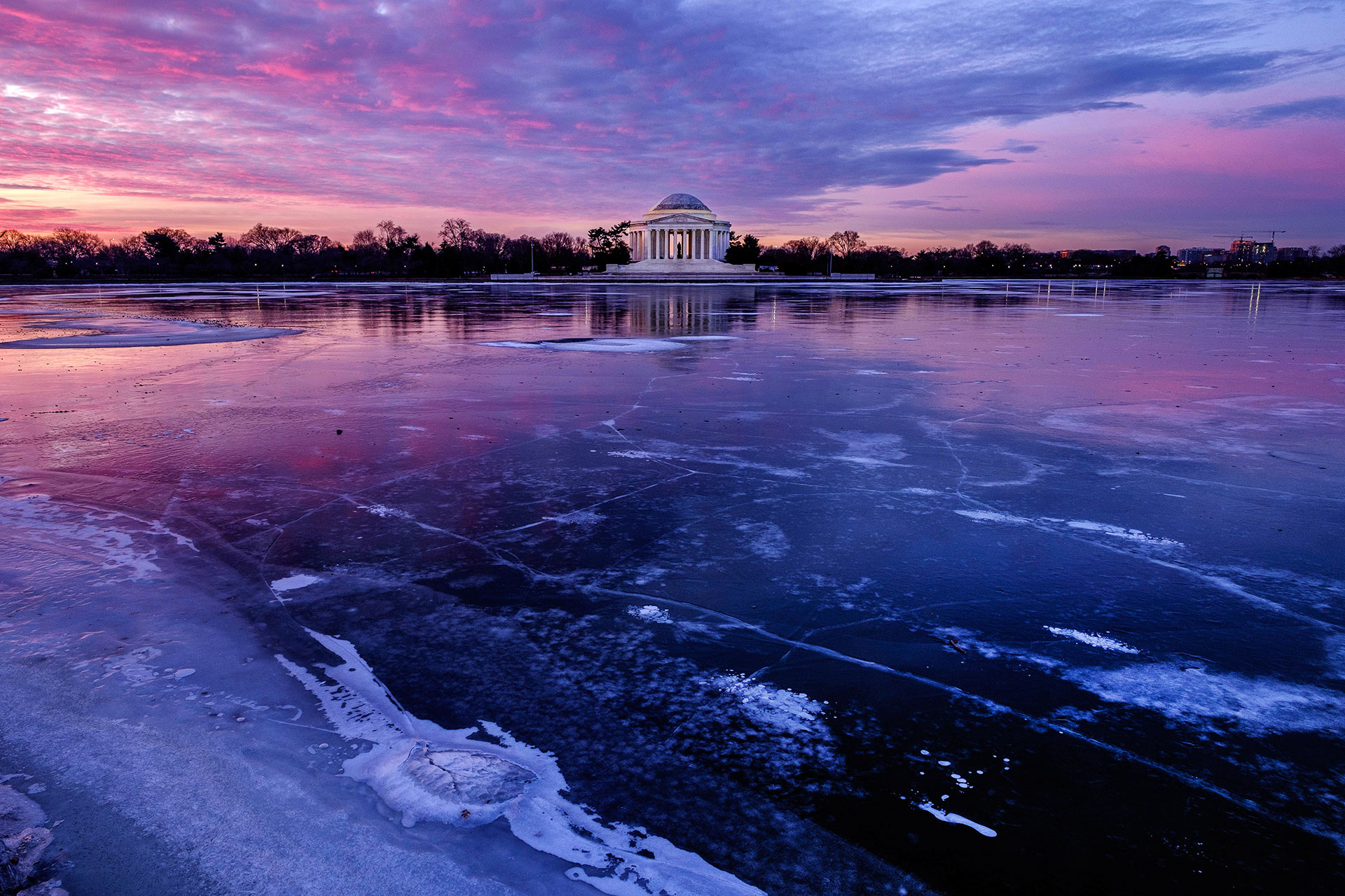 The Jefferson Memorial is reflected in the frozen surface of the Tidal Basin
