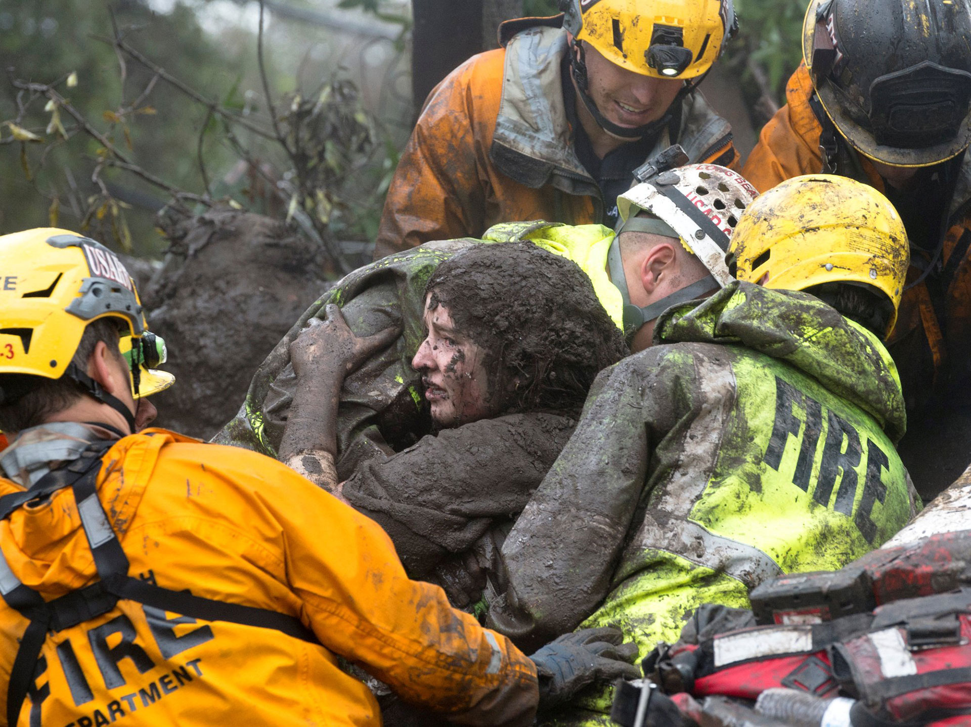 Firefighters rescue Lauren Cantin, 14, after she was trapped inside a home destroyed by a mudslide.