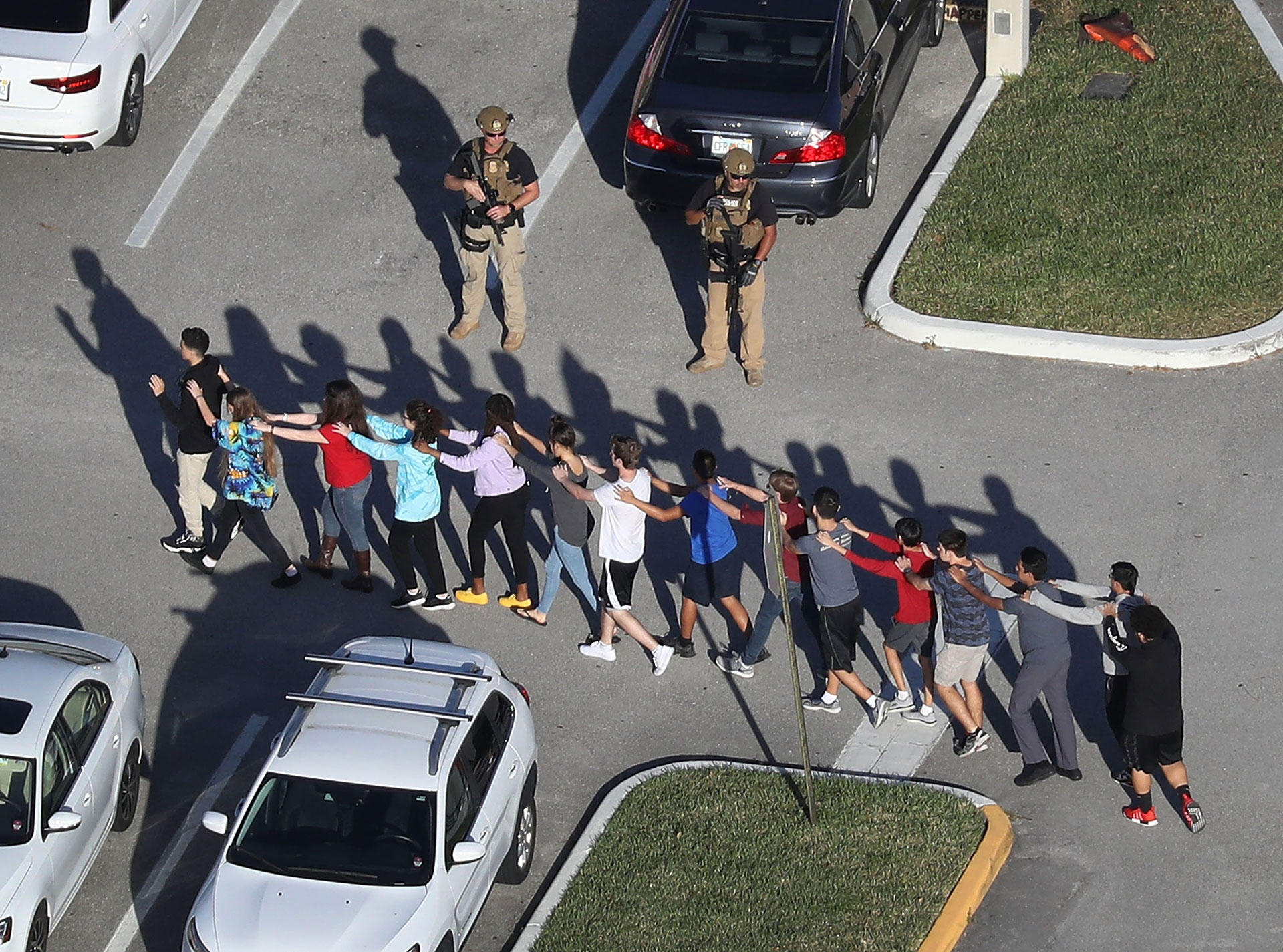 Students walk out of Marjory Stoneman Douglas High School in Parkland, Florida, on Feb. 14 after a former student opened fire