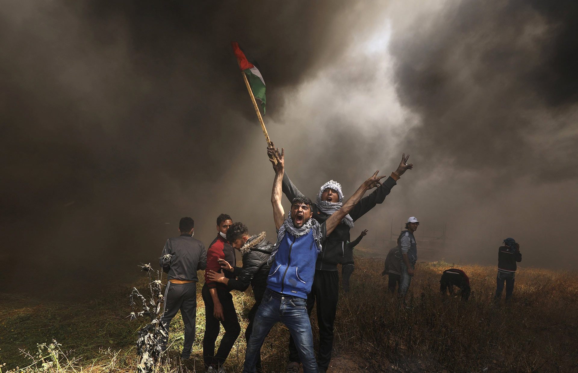 Palestinian demonstrators clash with Israeli troops at the Israel-Gaza border