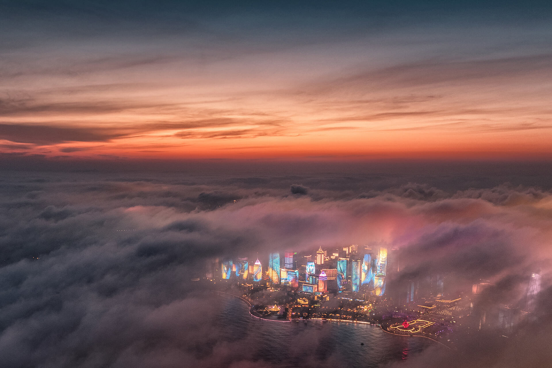 Fog drifts across skyscrapers on the waterfront in China