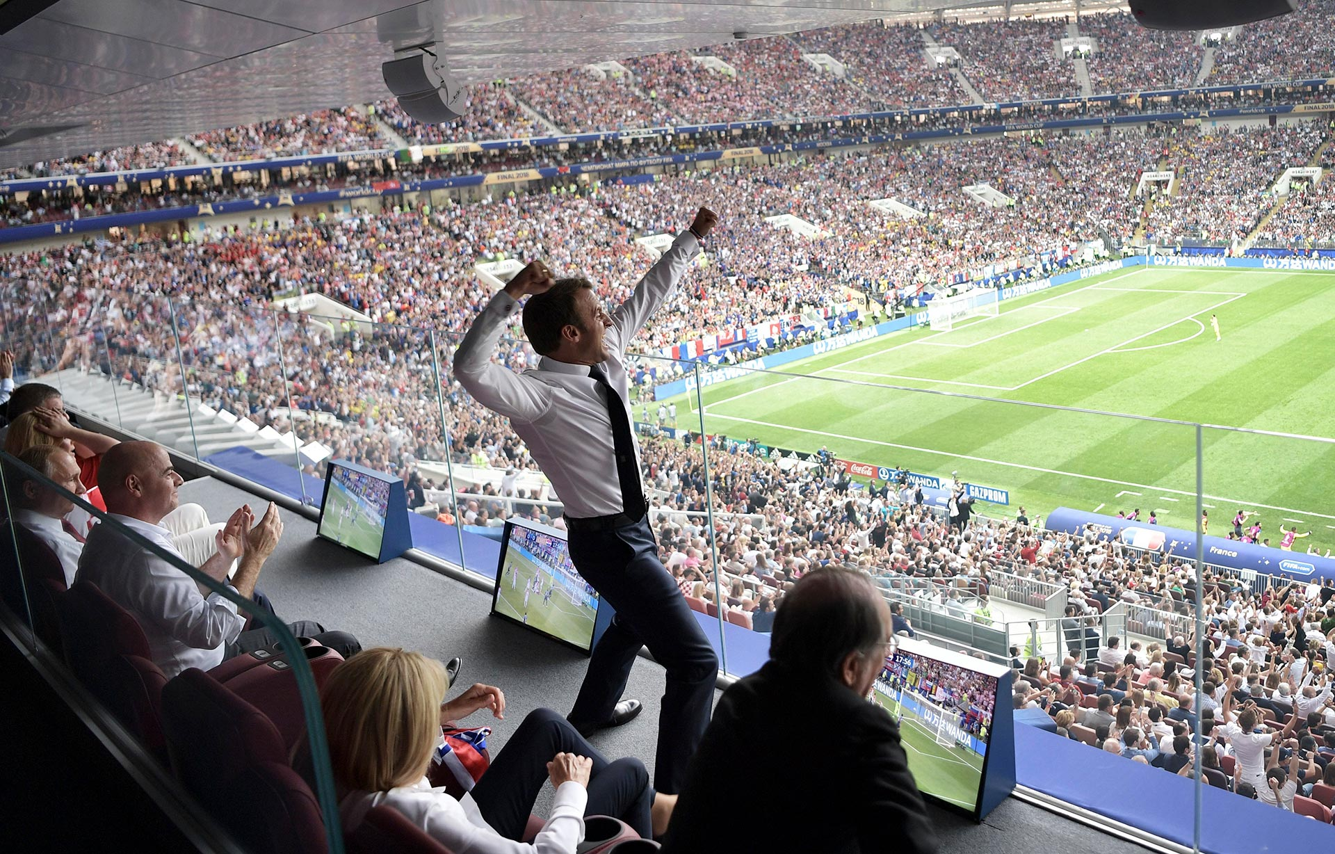 French President Emmanuel Macron cheers on France during the World Cup final