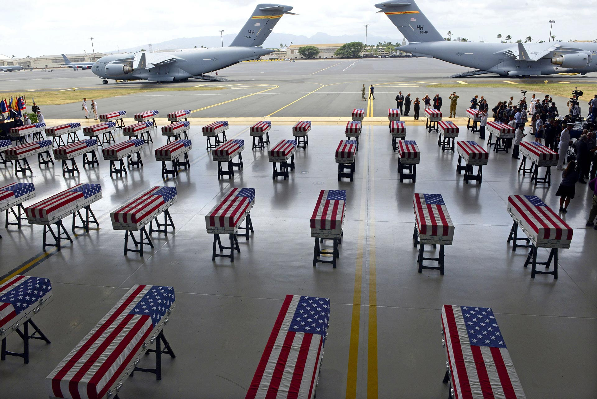 Transfer cases containing the remains of American soldiers repatriated from North Korea