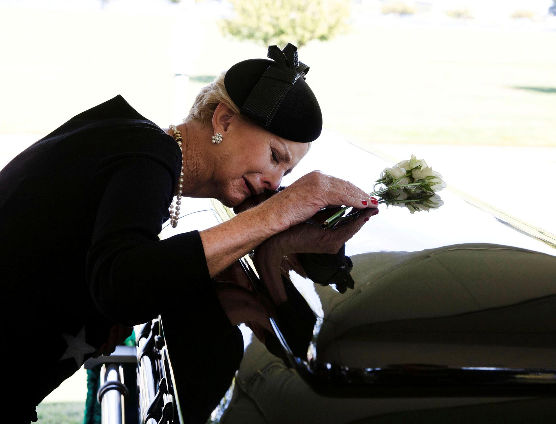 Cindy McCain with her husband's casket