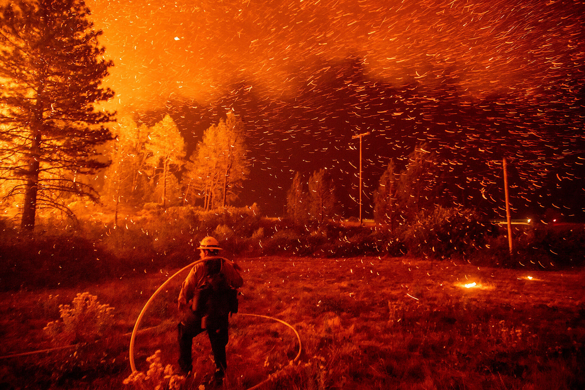 A firefighter works to control a backfire as the Delta Fire burns in California