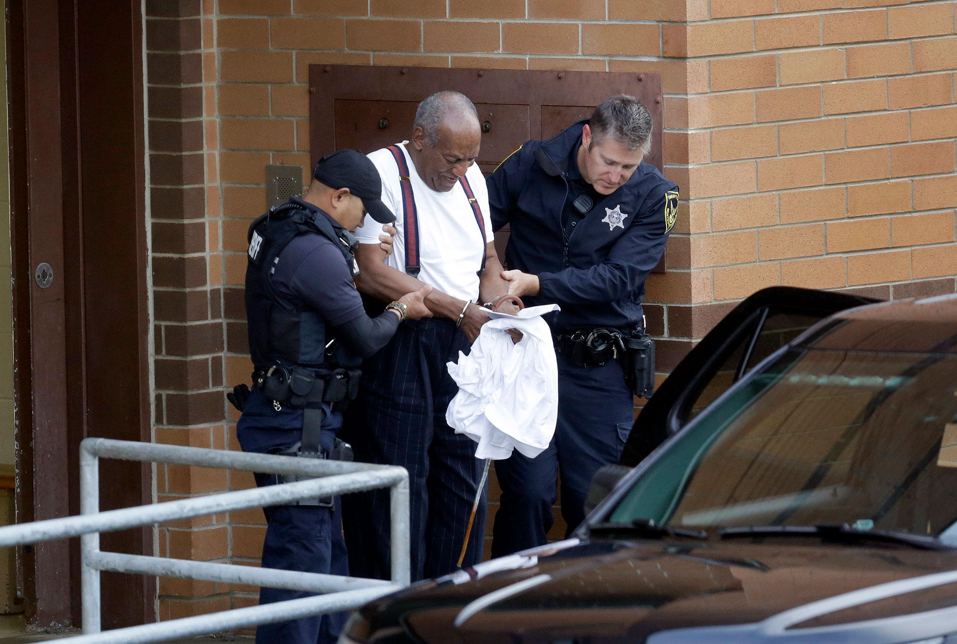 Bill Cosby is led in handcuffs