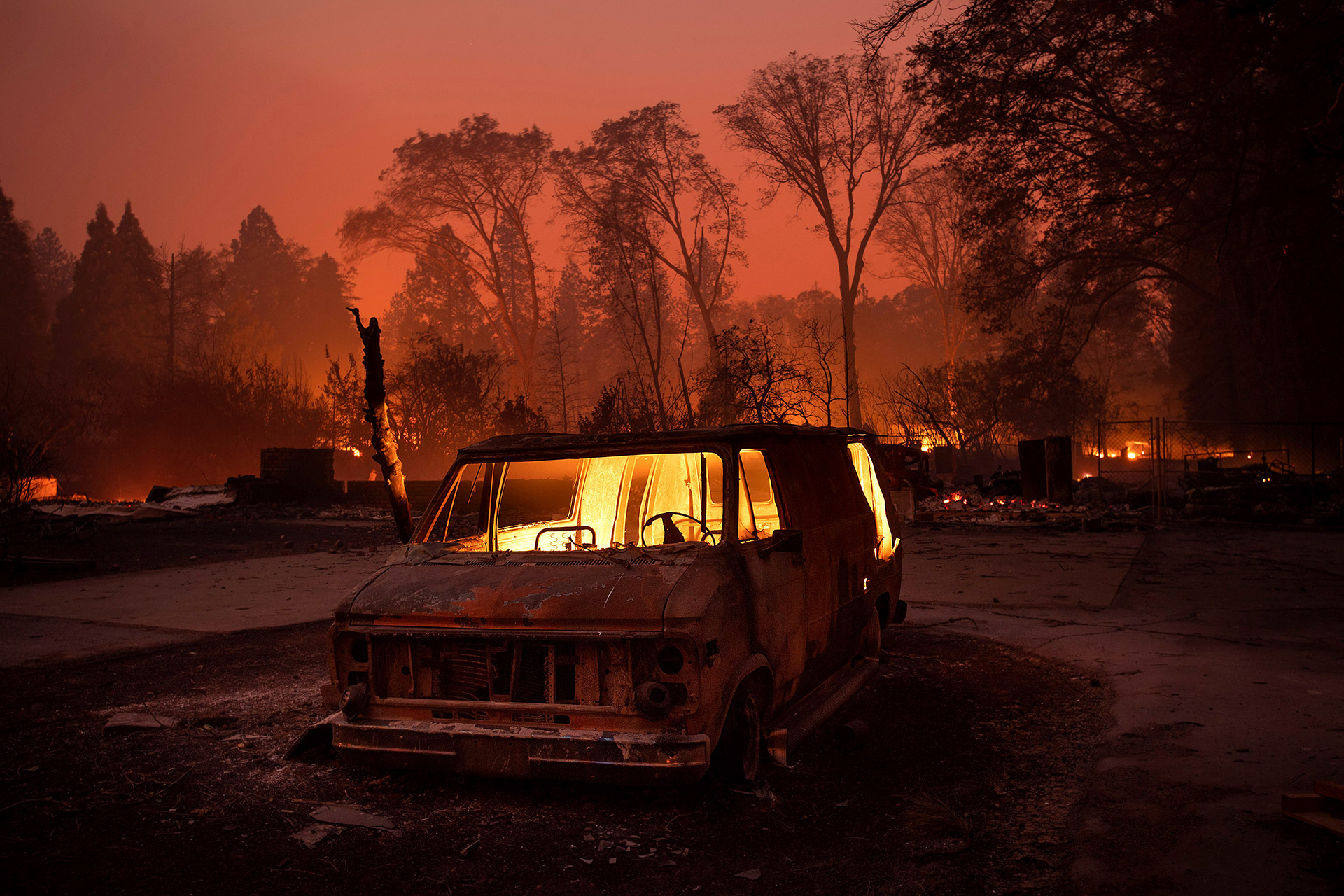 Flames burn inside a van as the Camp Fire tears through Paradise, California
