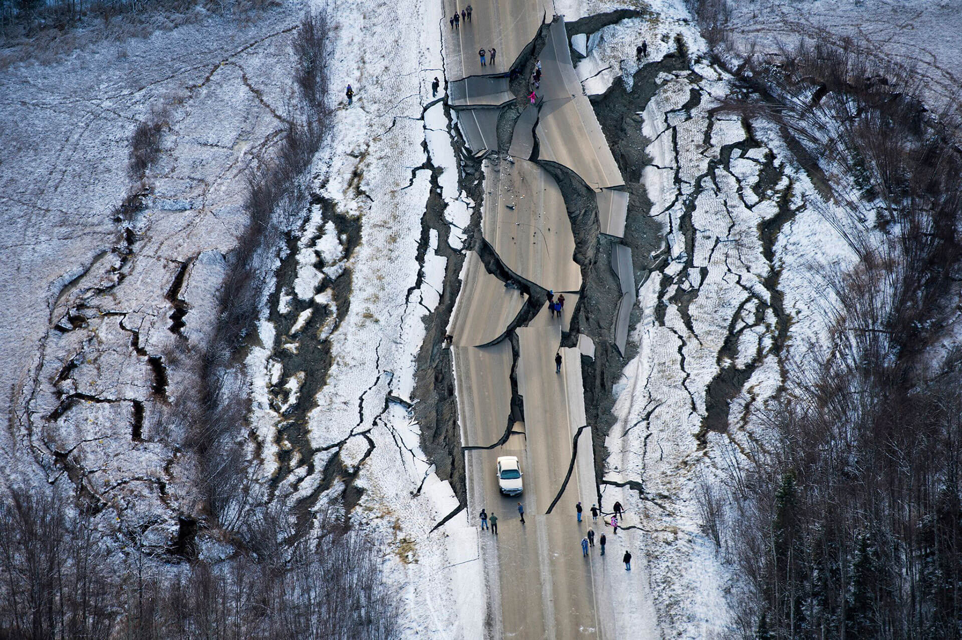A car is trapped on a damaged road south of Wasilla, Alaska