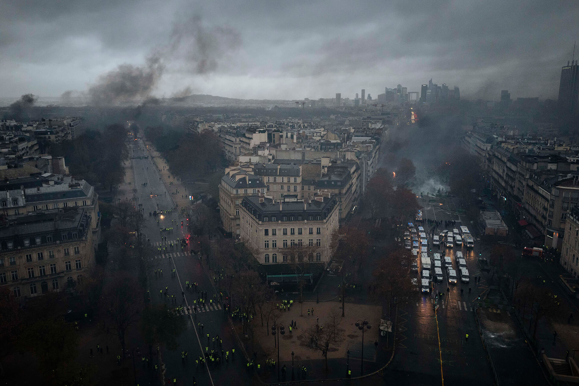 Smoke hangs over the avenues of Paris