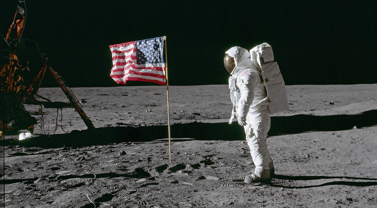 Buzz Aldrin poses next to the U.S. flag on the Moon.