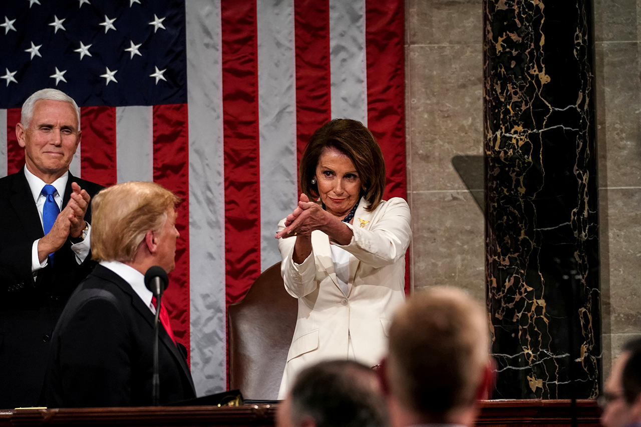 Speaker of the House Nancy Pelosi applauds President Donald Trump during the State of the Union address on Feb. 5.