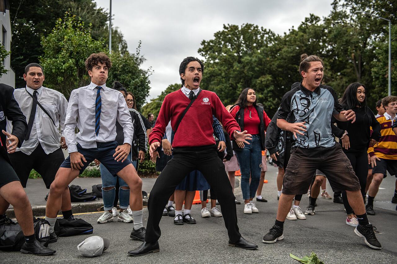 Students perform a traditional Maori haka during a vigil near Al Noor Mosque.