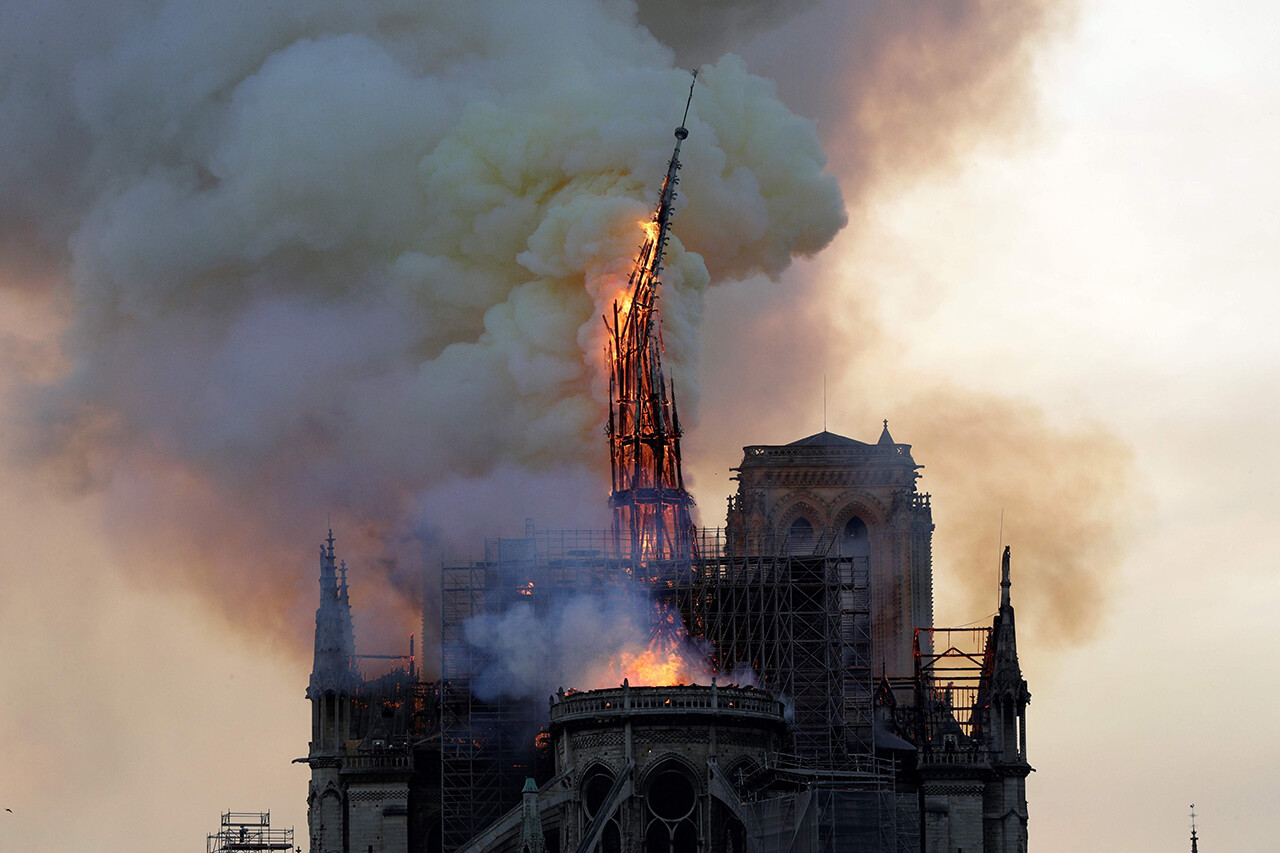 Notre Dame's steeple collapses as the cathedral is engulfed in flames in Paris.