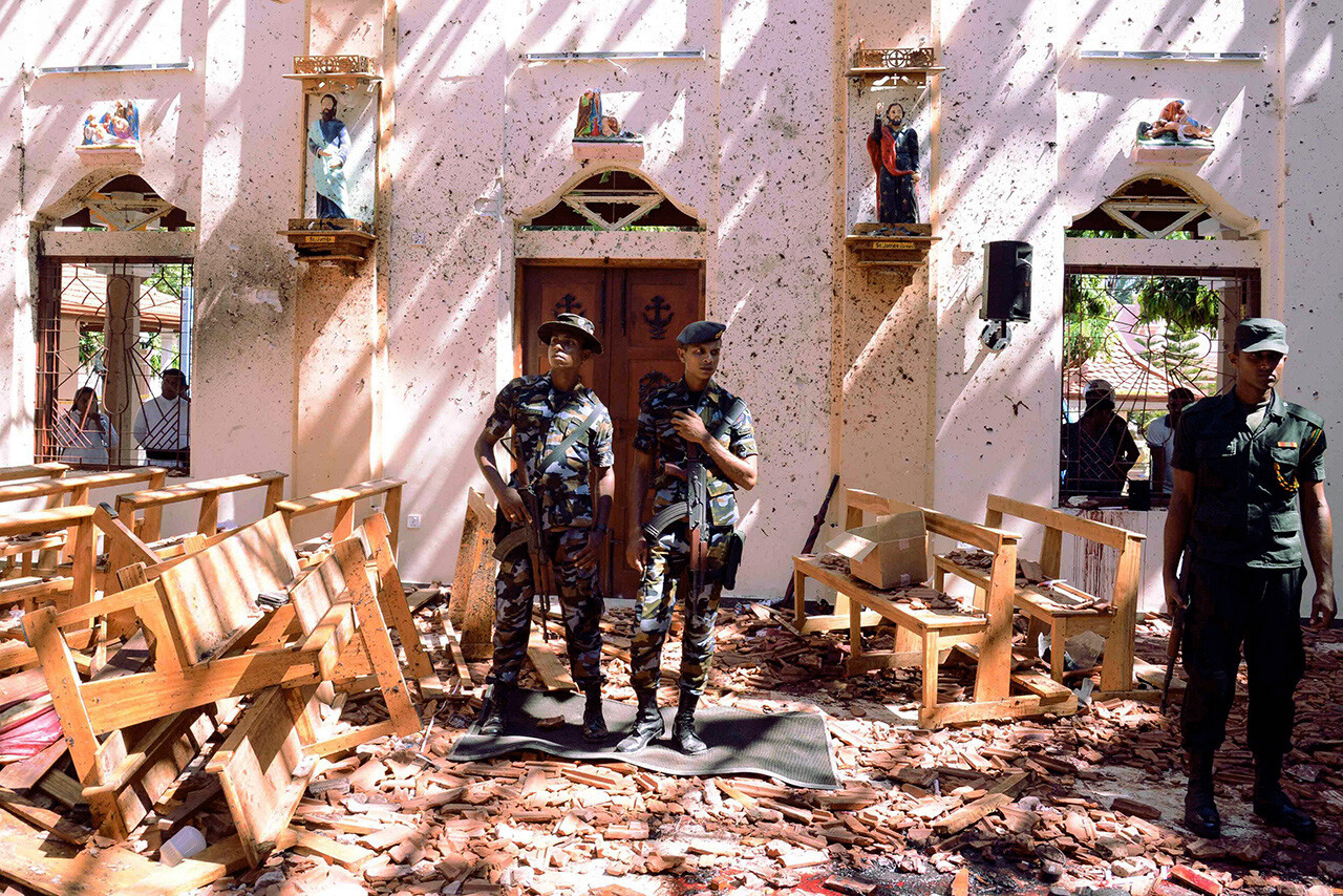 Soldiers stand inside St. Sebastian's Church in Negombo, Sri Lanka, following a bomb blast.