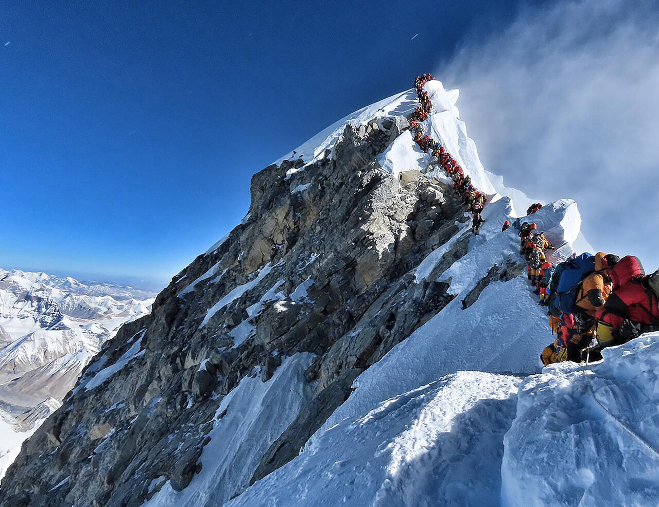 Climbers line up near the summit of Mount Everes.