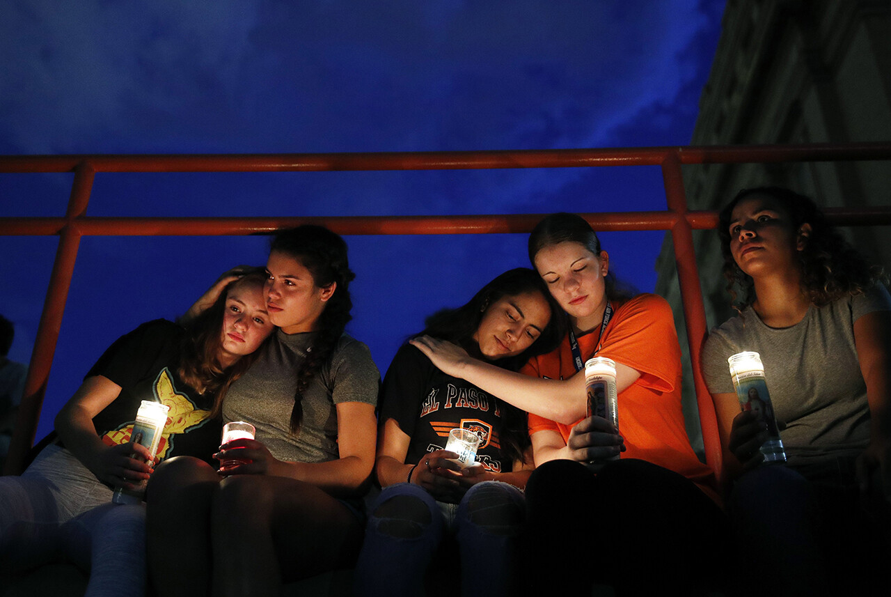 Melody Stout, Hannah Payan, Aaliyah Alba, Sherie Gramlich and Laura Barrios comfort one another during a vigil for victims of the mass shooting in El Paso, Texas.